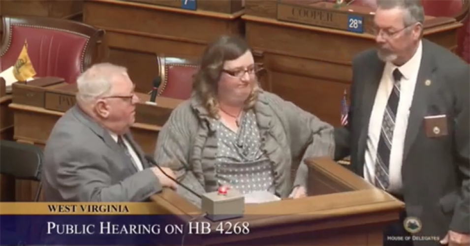woman dragged out of house hearing Oil and Gas Contributions